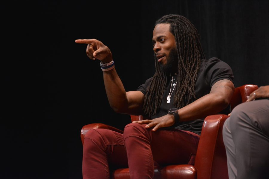 Seattle+Seahawks+cornerback+Richard+Sherman+points+to+the+crowd+after+an+audience+member+shouts+out+his+alma+mater%2C+Stanford+University.