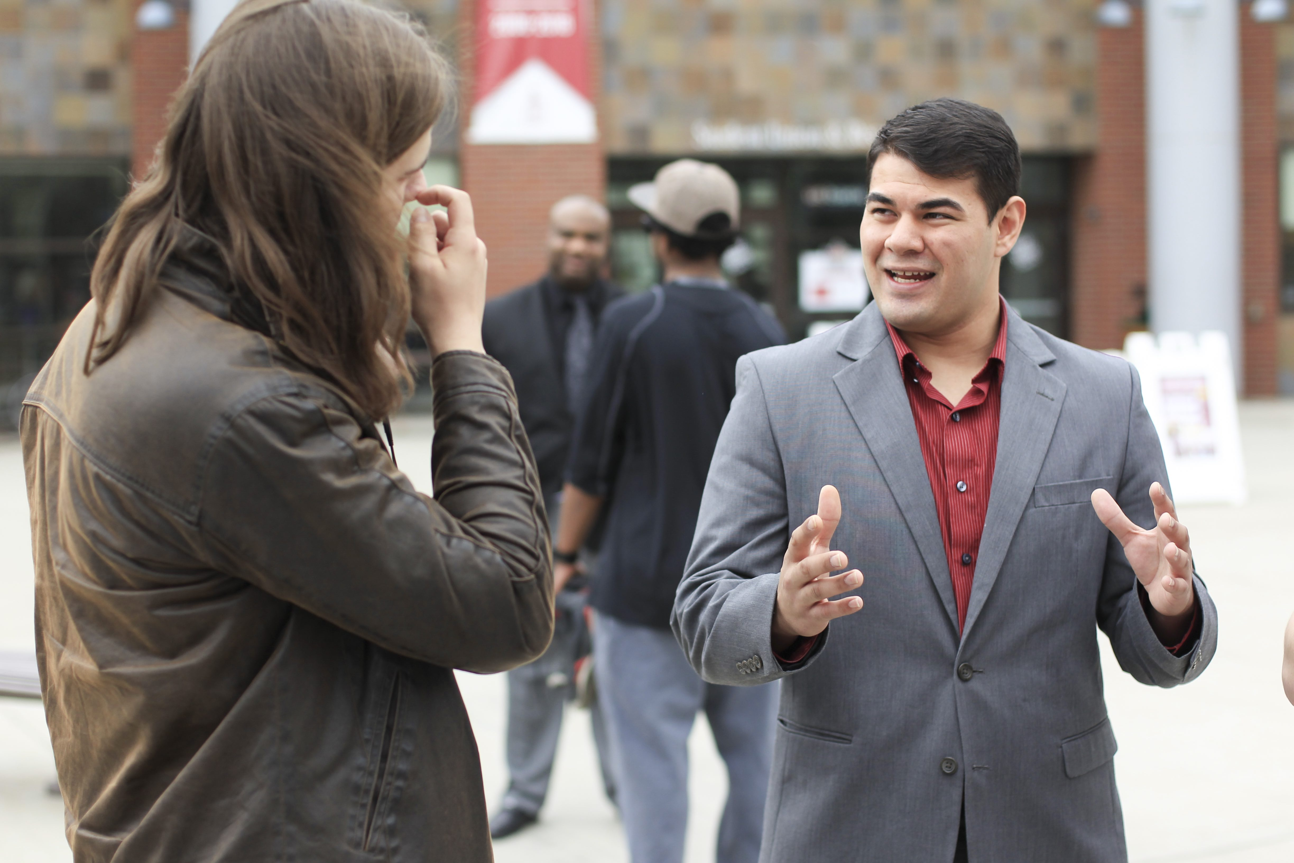 Current ASCWU VP of Legislative Affairs JR Siperly (right) speaks to junior broadcast journalism student Rune Torgersen, after a press conference on April 5.