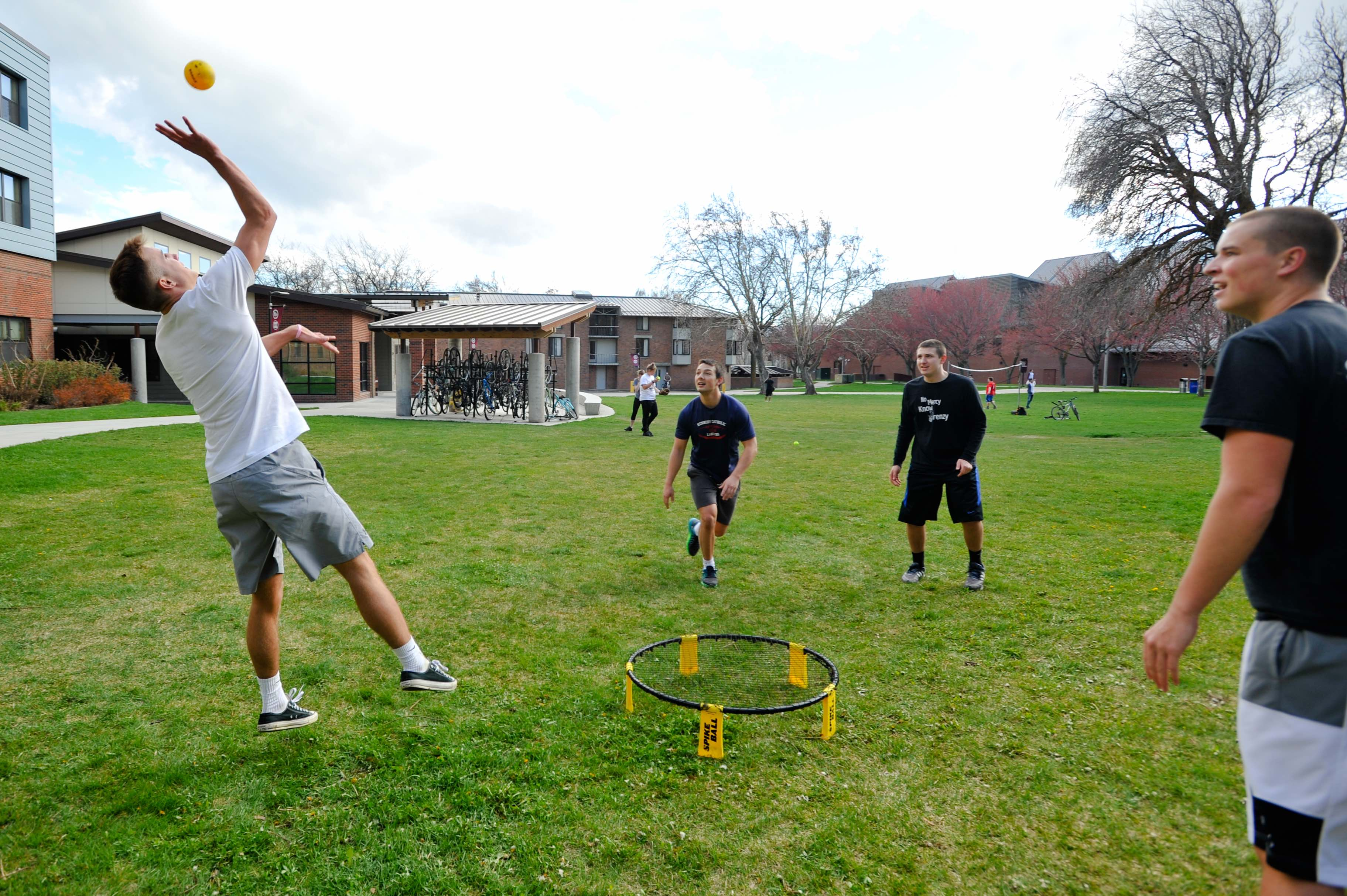 Barto residents partake in spikeball on a sunny spring day. Tuesday, April 18.  In the background, other students play volleyball with a net from OPR.