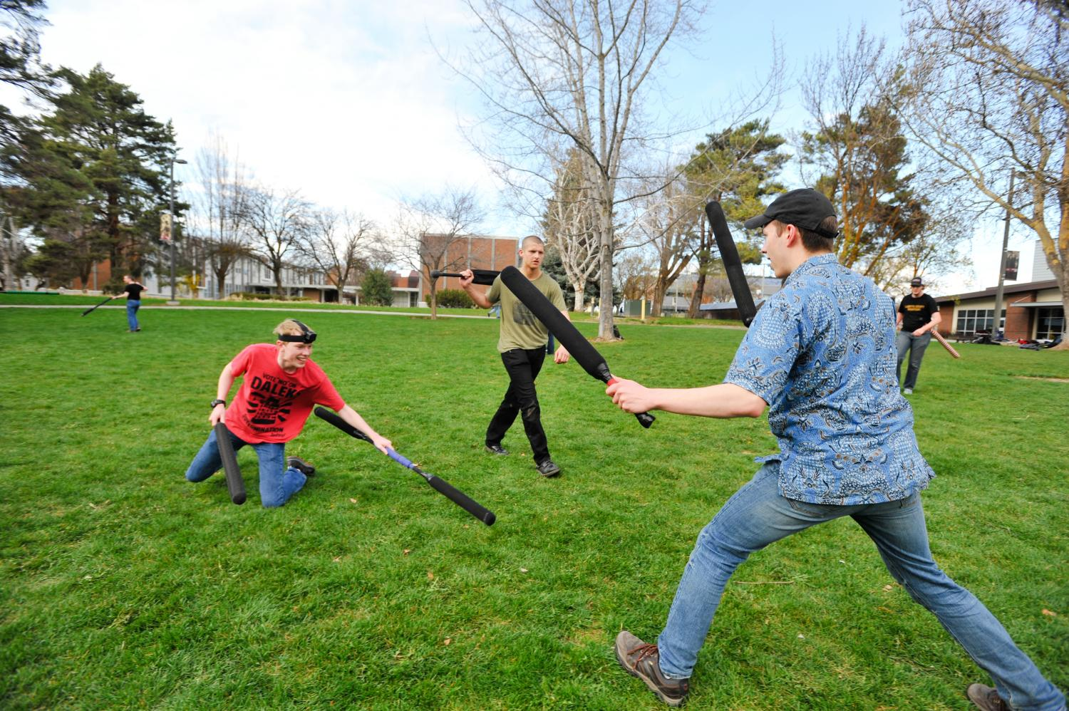 Members of the Boffering Club spar each other by the Recreation Center. They hope to be recognized as a club by fall quarter.