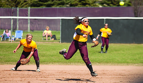 Zach Olney/Observer Freshman Andrea Hamada throws to first base during a game against Simon Fraser.