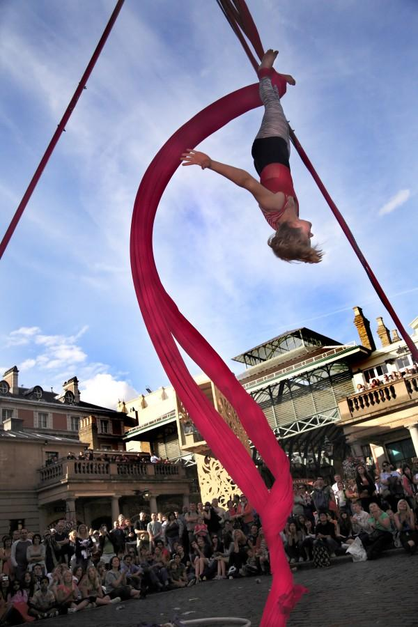 The Aerial Angels perform for a crowd in Covent Garden, London.  Photo courtesy of Fehmi Comert.