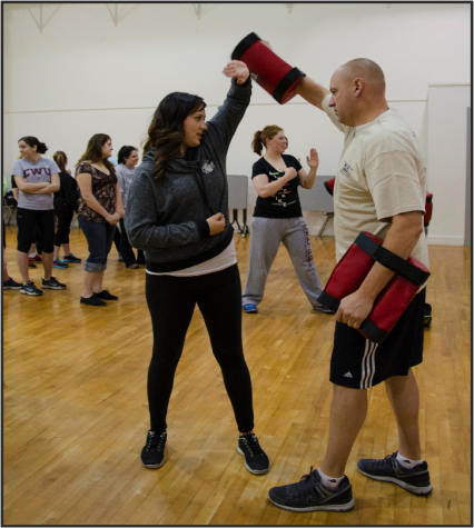 Female students learn self defense with university class