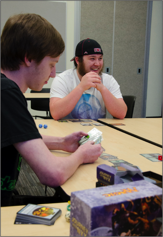 Barto RA, Cody Taylor, gathers students with Magic: The Gathering