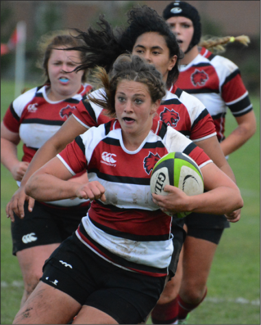 DETERMINATION - Captain Heather Johnson muscles her way through the defense.  Johnson is a 5'6 senior forward (hooker) from Dixmont, Maine  and has played rugby for four years.