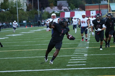 IN THE CLEAR - Austin Pernell returns the first of two blocked punts the Wildcats had for touchdowns against Simon Fraser University (B.C.) in the inaugural Battle of the Border