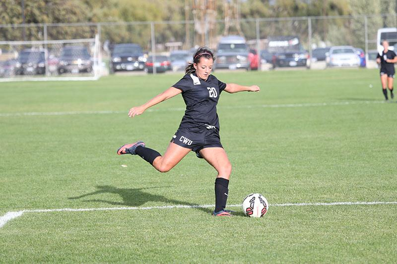 SEND OFF - Forward Whitney Lowe prepares to pass the ball to a teammate
