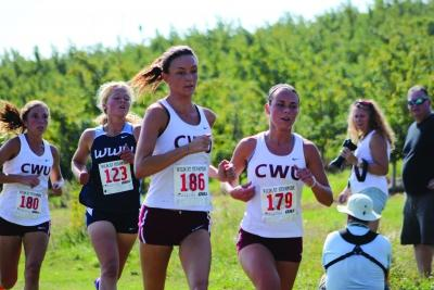Dani Eggleston (right) and Megan Rodgers (left) lead the pack of runners at a meet.