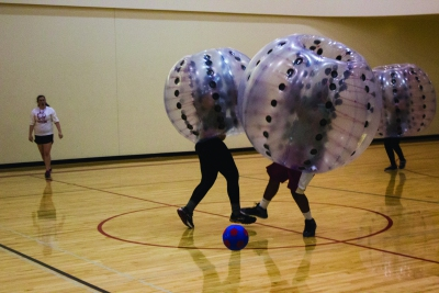 Intramural participants compete in the bubble ball soccer championship game