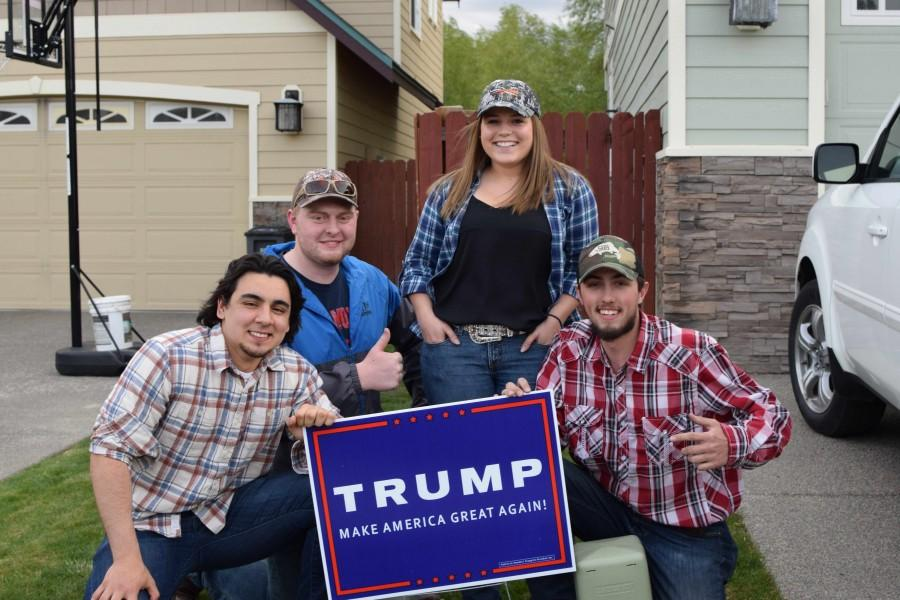 Students+for+Trump+supporters+rally+around+a+sign+outside+of+the+campus+Republicans+meeting.+Ammon+%28left%29+is+the+leader.