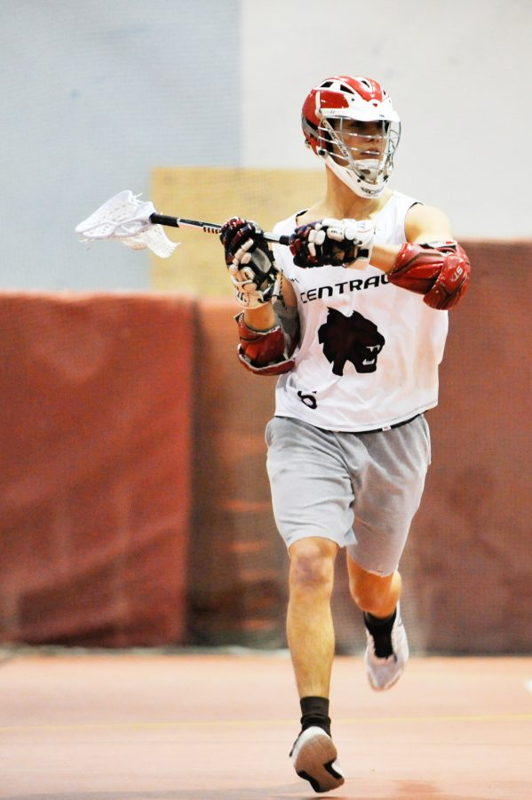 CWU+freshman+midfielder+Riley+O%E2%80%99Neil+runs+with+the+ball+during+one+of+their+late+night+practices+from+all+of+the+winter+weather.
