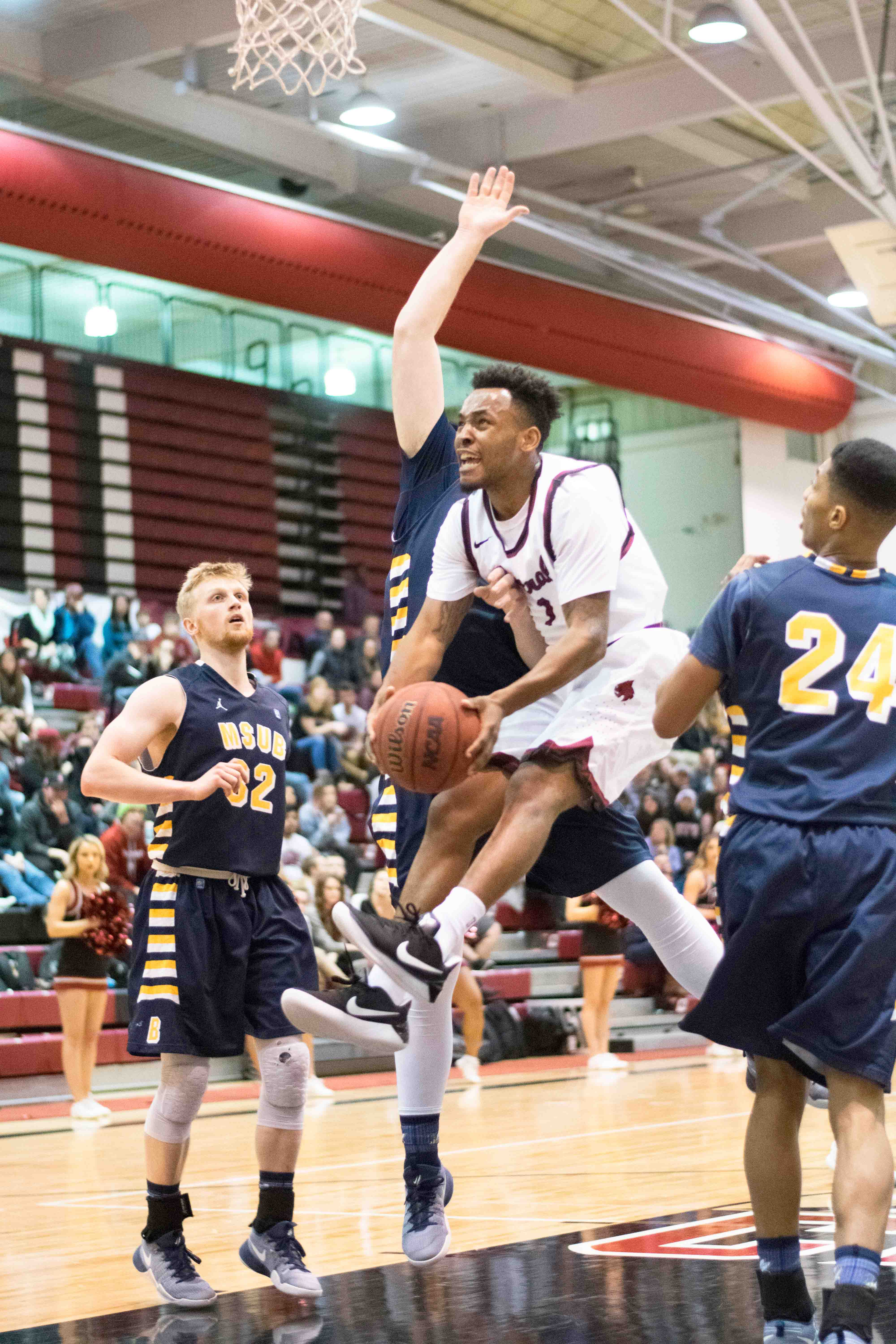 Junior guard Marc Rodgers drives to the basket during a game against Montana State Billings.