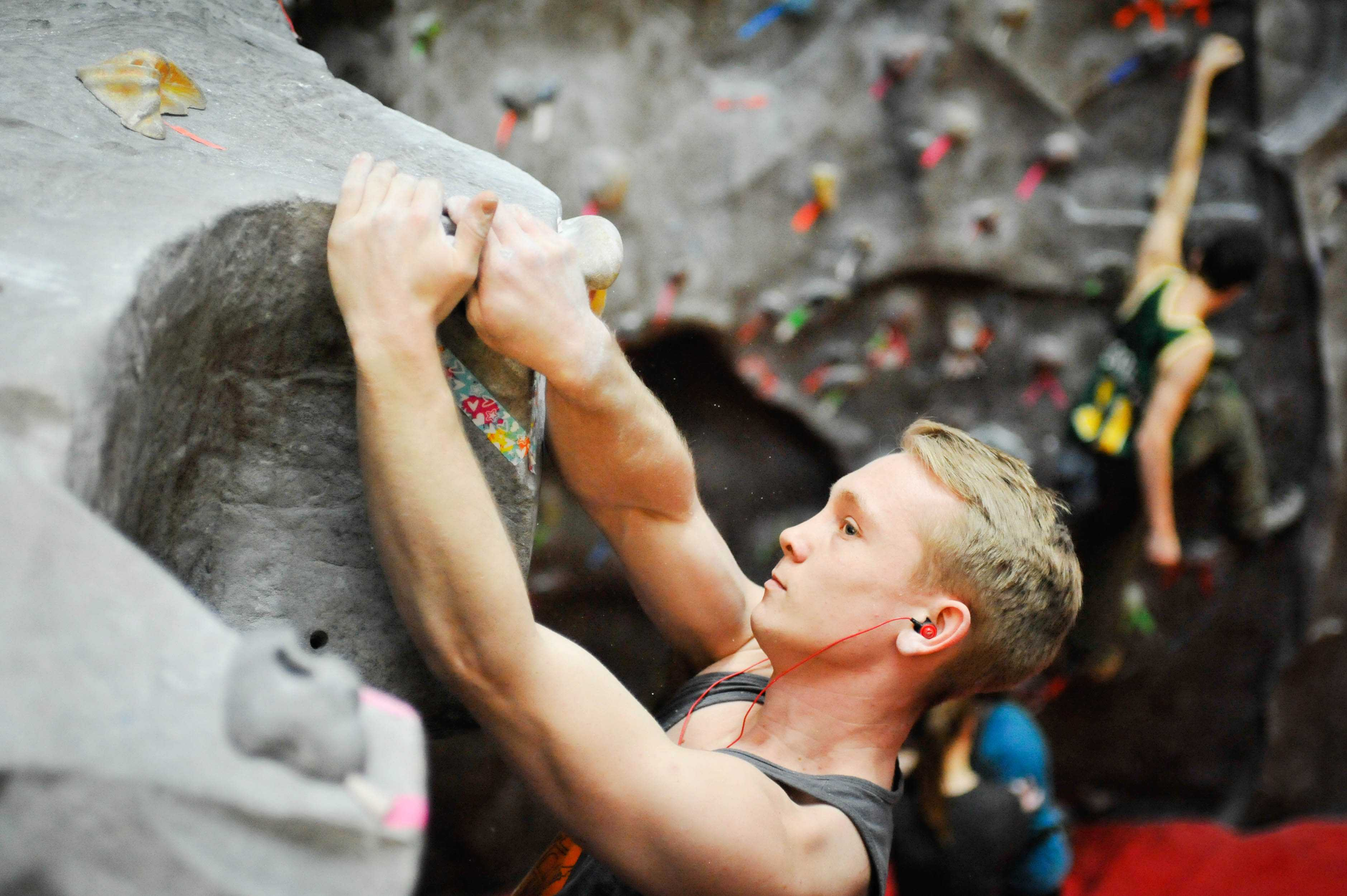 Dan Connelly (pictured) scales the wall during a practice. He is one of the top point placers on the CWU Climbing club roster. The team is currently ranked third in the standings.