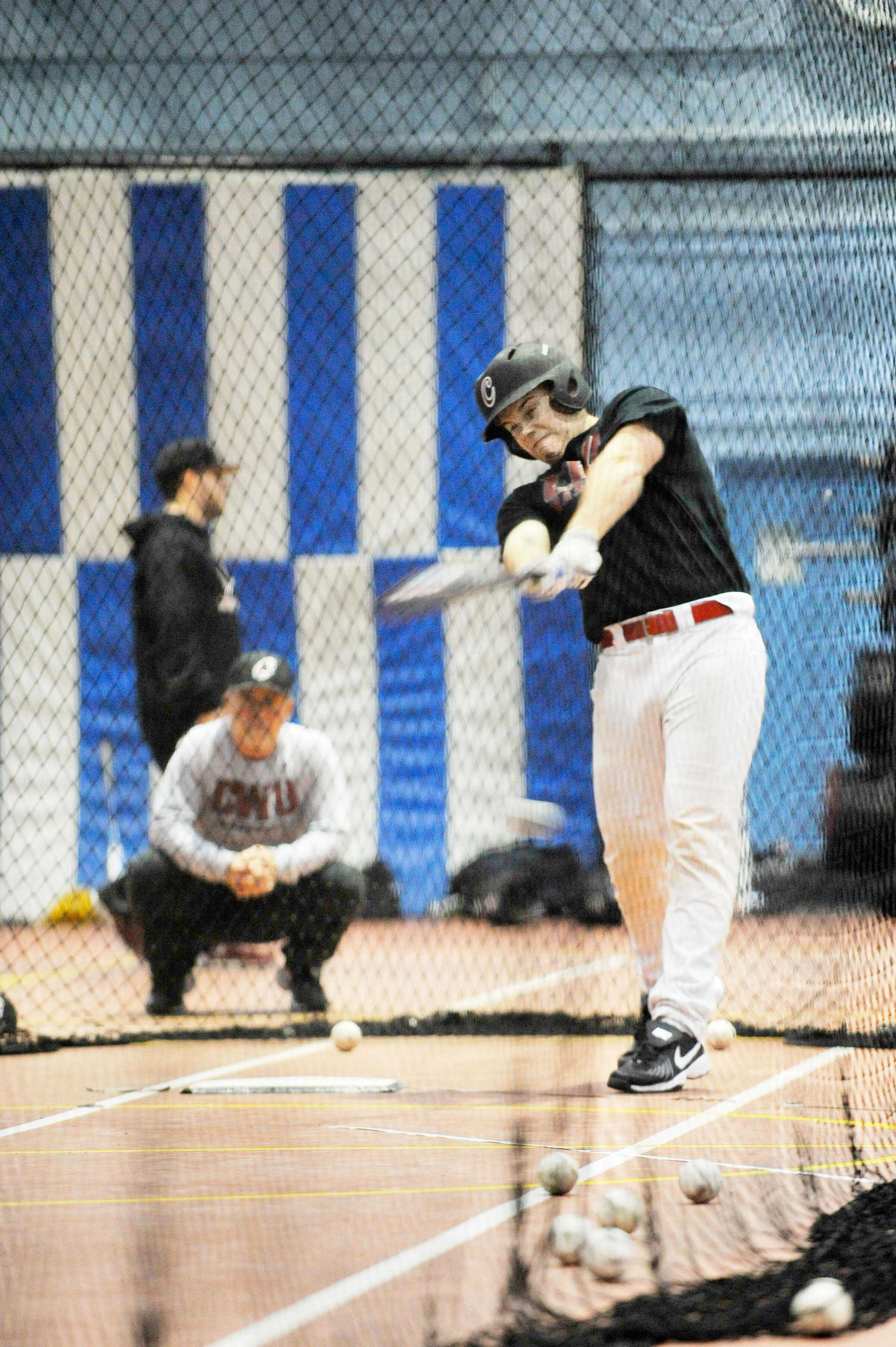CWU freshman catcher Jesse Unger takes batting practice during an indoor sessions.