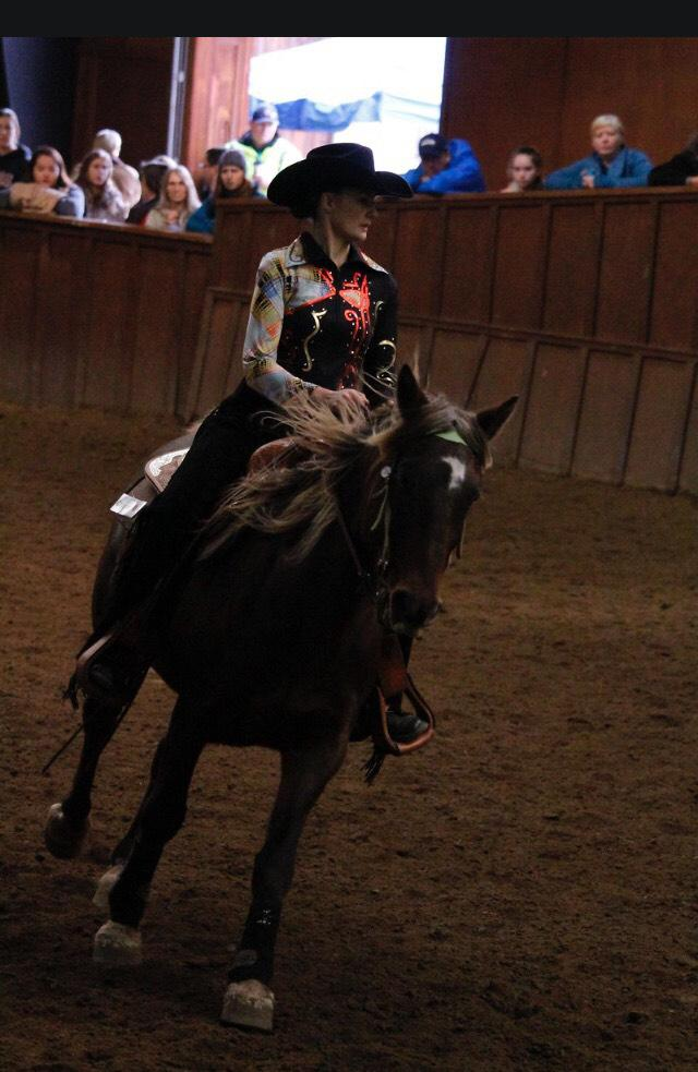 The CWU Equestrian team competes during western style riding at a competition.