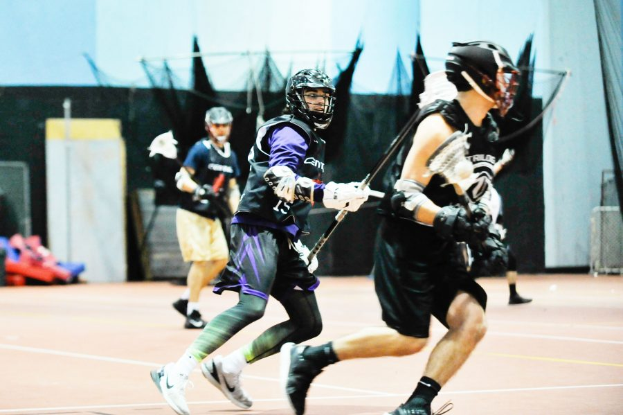 CWU lacrosse player Justin Abercrombie runs across the Nicolson Pavilion Fieldhouse during one of their late night practices. Their season gets underway this weekend.