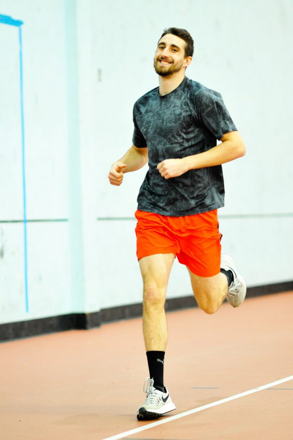 Kodiak Landis warming up with a light jog during an afternoon track practice.