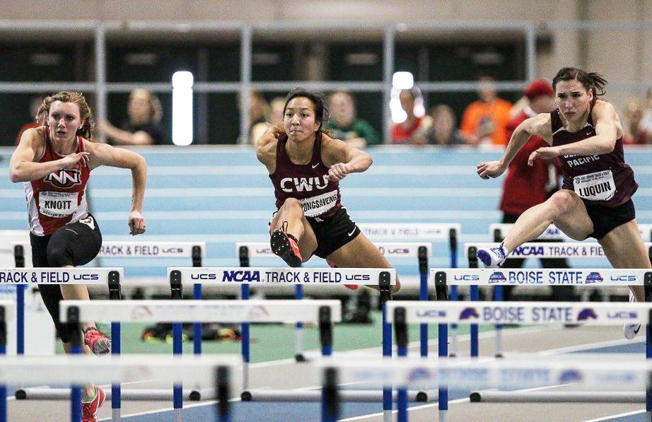 Mariyah Vongsaveng runs over a hurdle during a competition. She now holds the GNAC record.