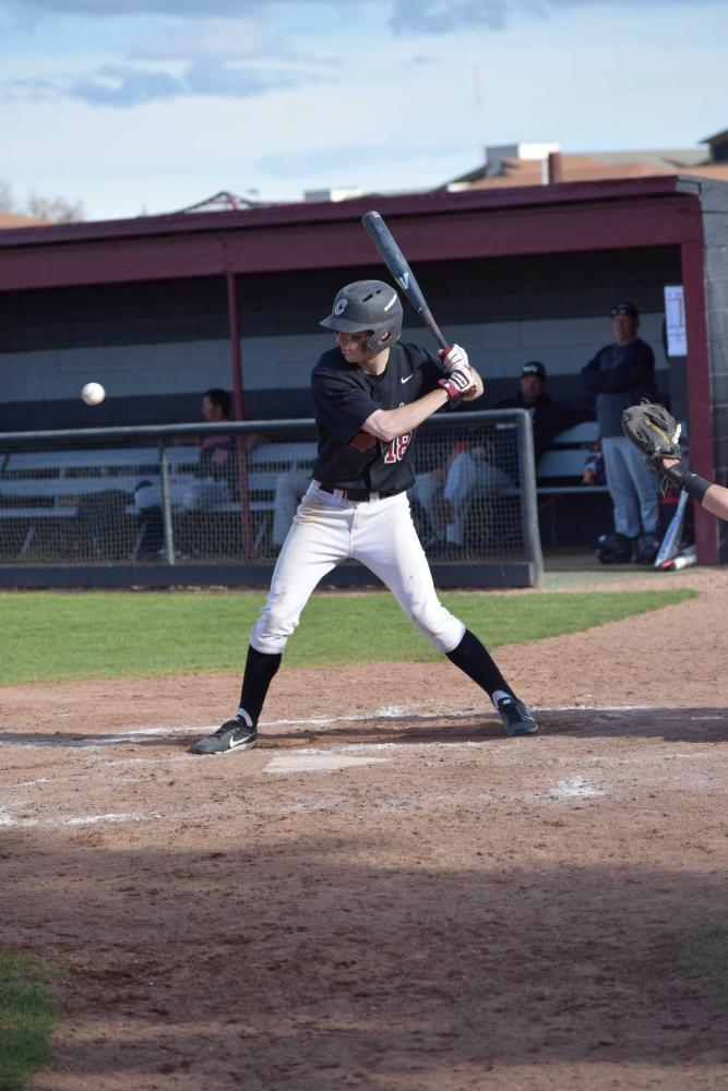 Freshman Justin Hampson takes a look at a pitch during their series with Northwest Nazarene.