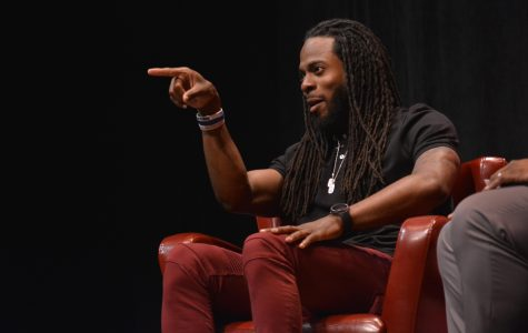 Sherman intercepts Students of Color Summit