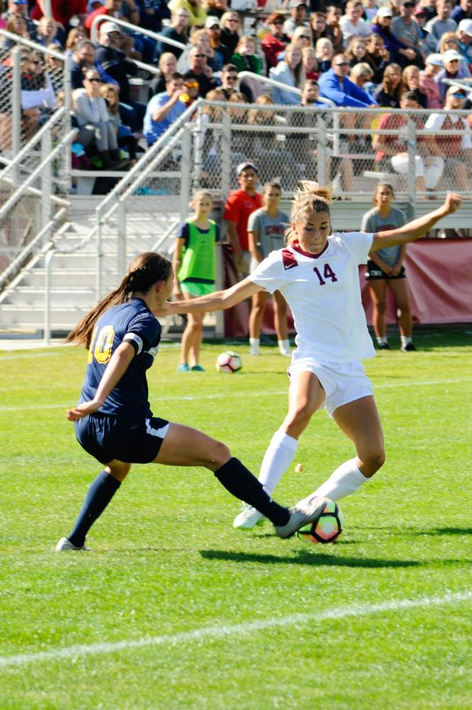 Mackenzie Nolte going around a defender during a 3-0 win over Montana State Billings.