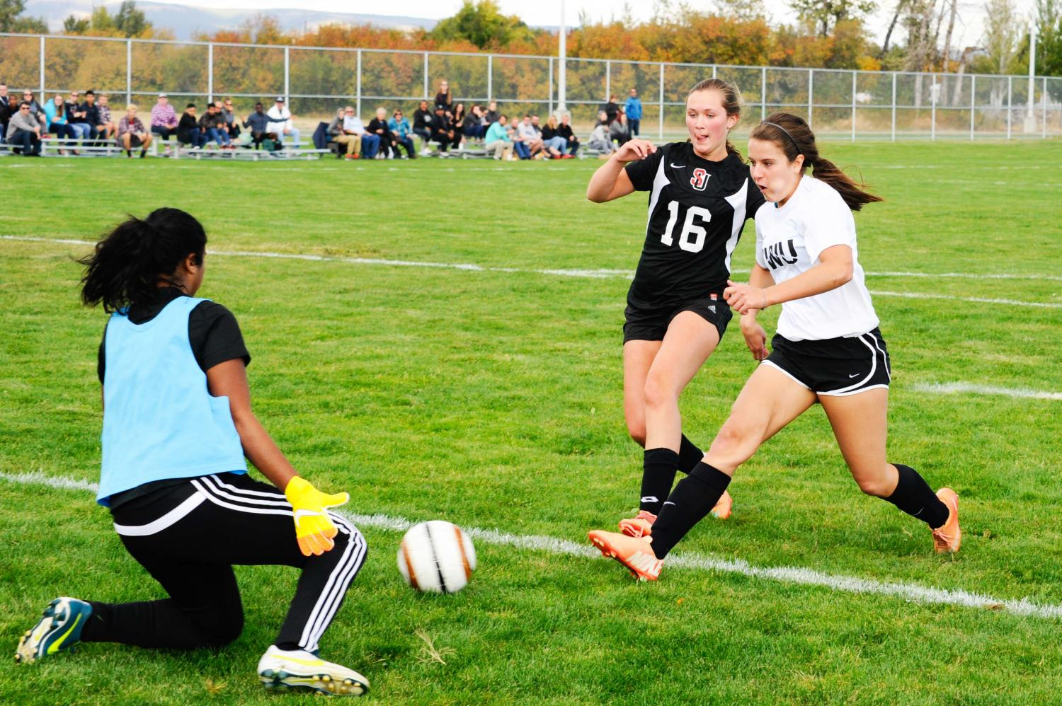 Junior forward Sally Vlas trying to get the ball past the Seattle University goalkeeper during a matchup in the fall.