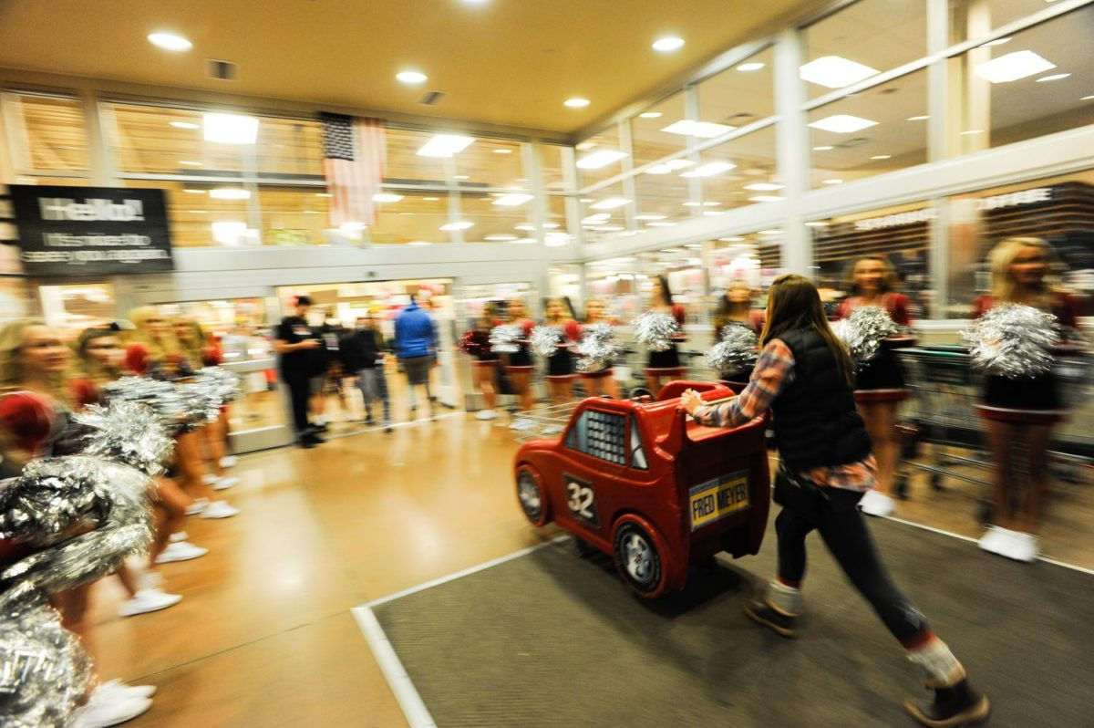 Students rush into Fred Meyer during last years event. The event would normally run on Tuesday, with Bite of the Burg.