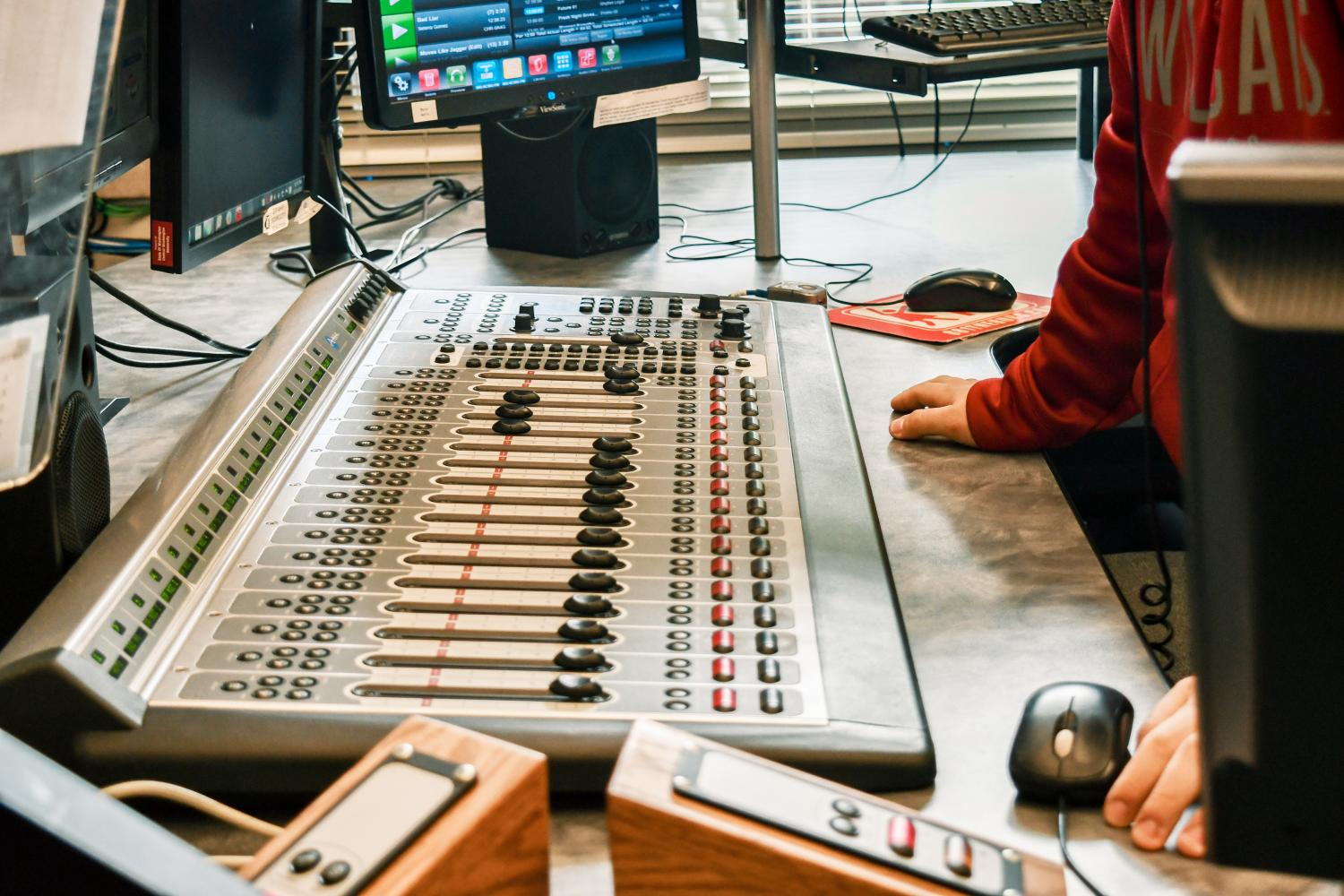 An 88.1 The 'Burg DJ mixes in the studio in between songs. The station has recently changed their song towards Top-40. Mikaela Nickolds/The Observer
