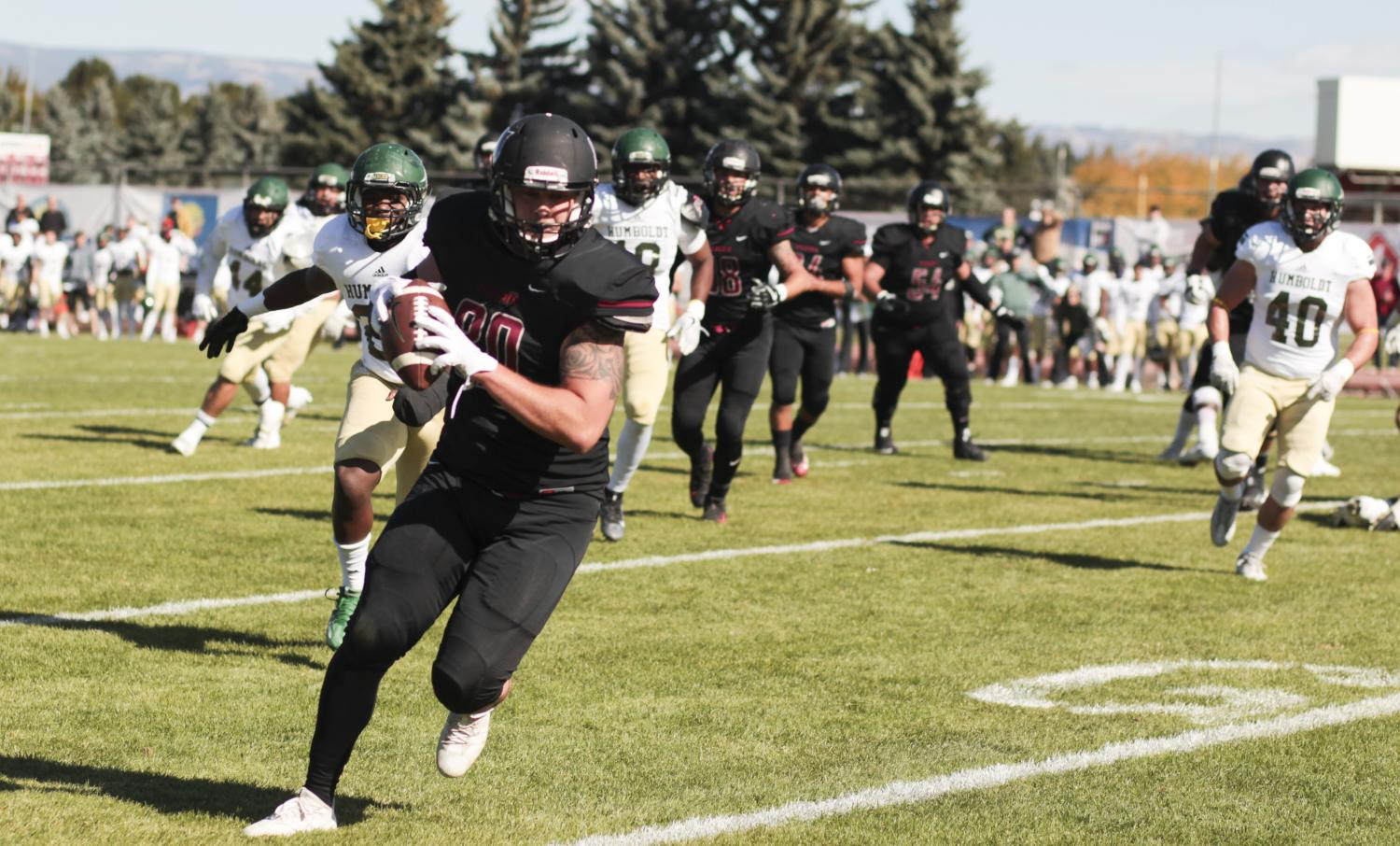Junior Dillon Sugg runs ahead of teammates and opponents during a home game on Oct. 7 vs. Humboldt State University.