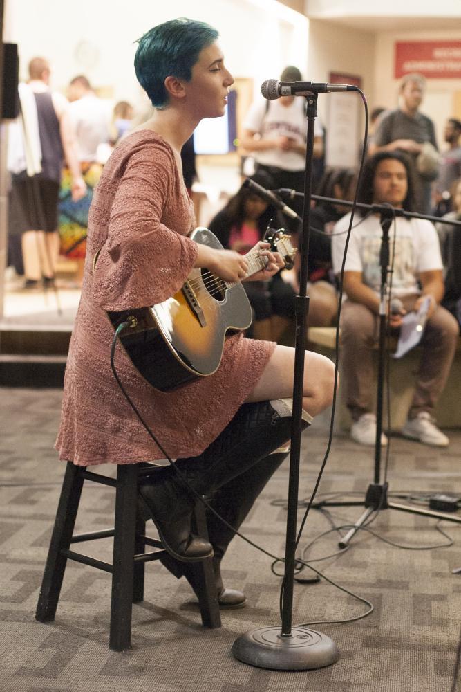 Jordan Richardson strums along as she performs.