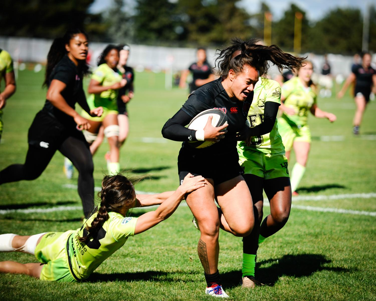 Suiluanna A'au breaks free of her Life University opponents during a home match. A'au currently leads the team in tries.