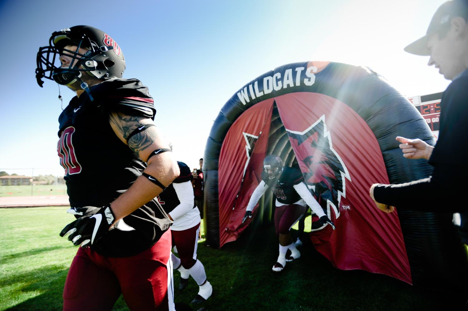 Players enter through the tunnel.