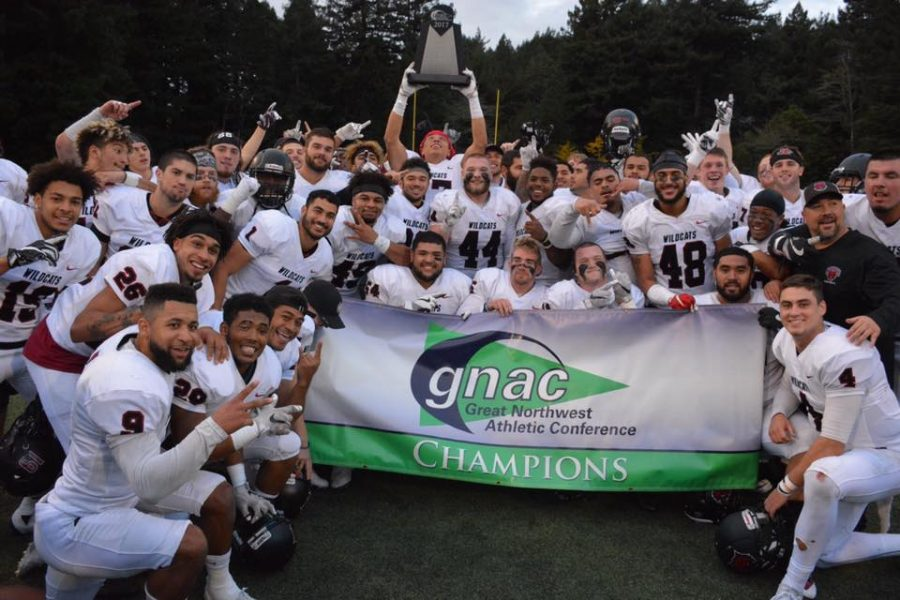 The+GNAC+champion+Wildcats+pose+with+the+championship+banner+after+defeating+Humboldt+State+University+42-28+Nov.+11.+The+Wildcats+will+now+prepare+for+the+playoffs.