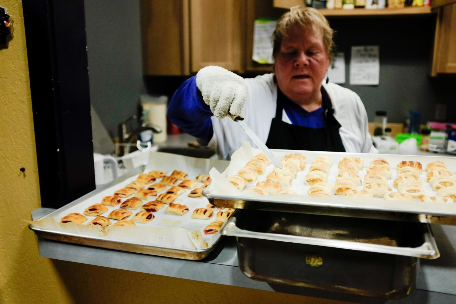 Lori Fritts, the kitchen manager at the FISH food bank, manages the hot meals that are served. She does all her cooking with the oven, crock pot and toaster pan located in their kitchen.