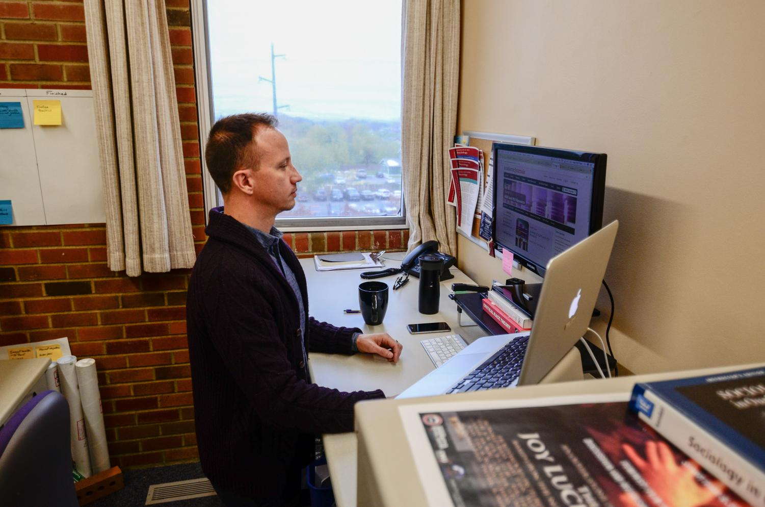 Tester in his office overlooking the Northwest side of campus. Tester will take the position of director of undergraduate research. Eric Rosane/Observer.