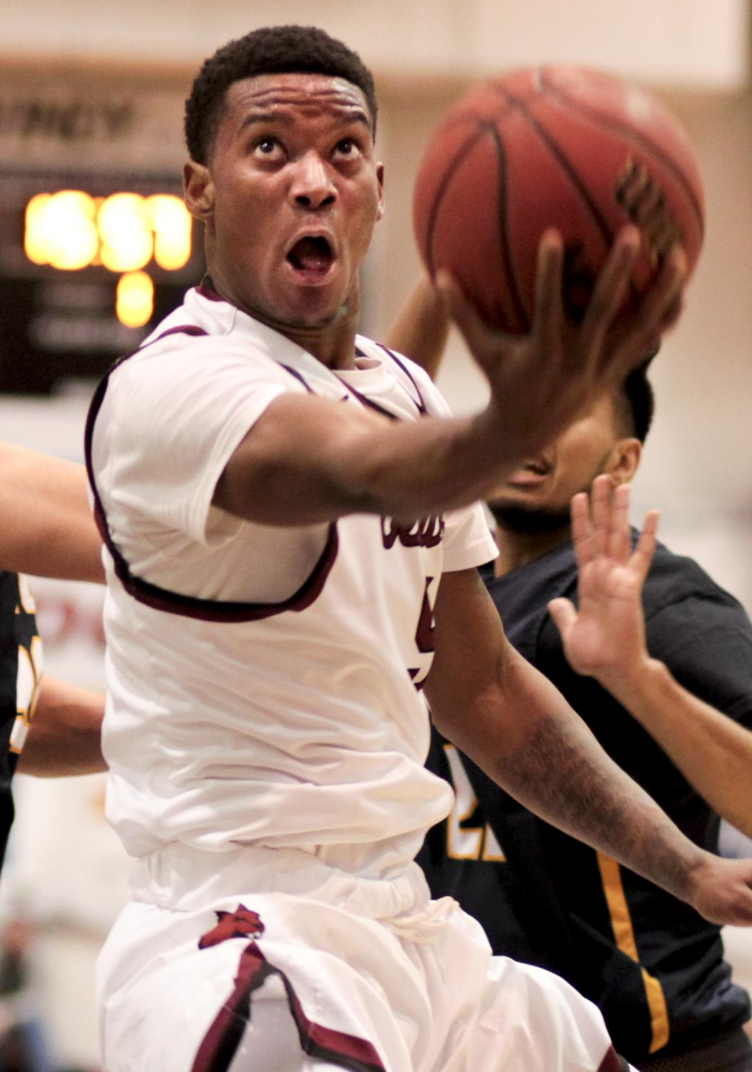 Japan Stepney goes up for a basketball in the Oct. 31 game against Northwest University.