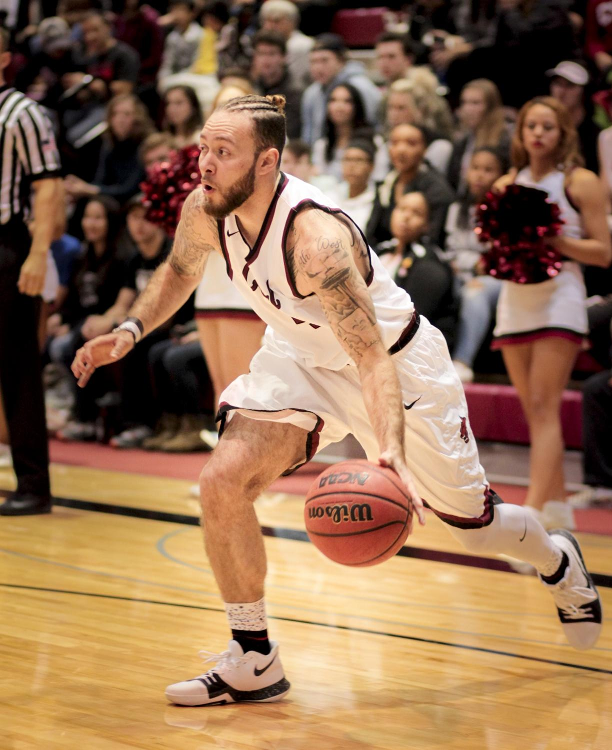 Malik Montoya dribbles during CWU's first home game of the season.