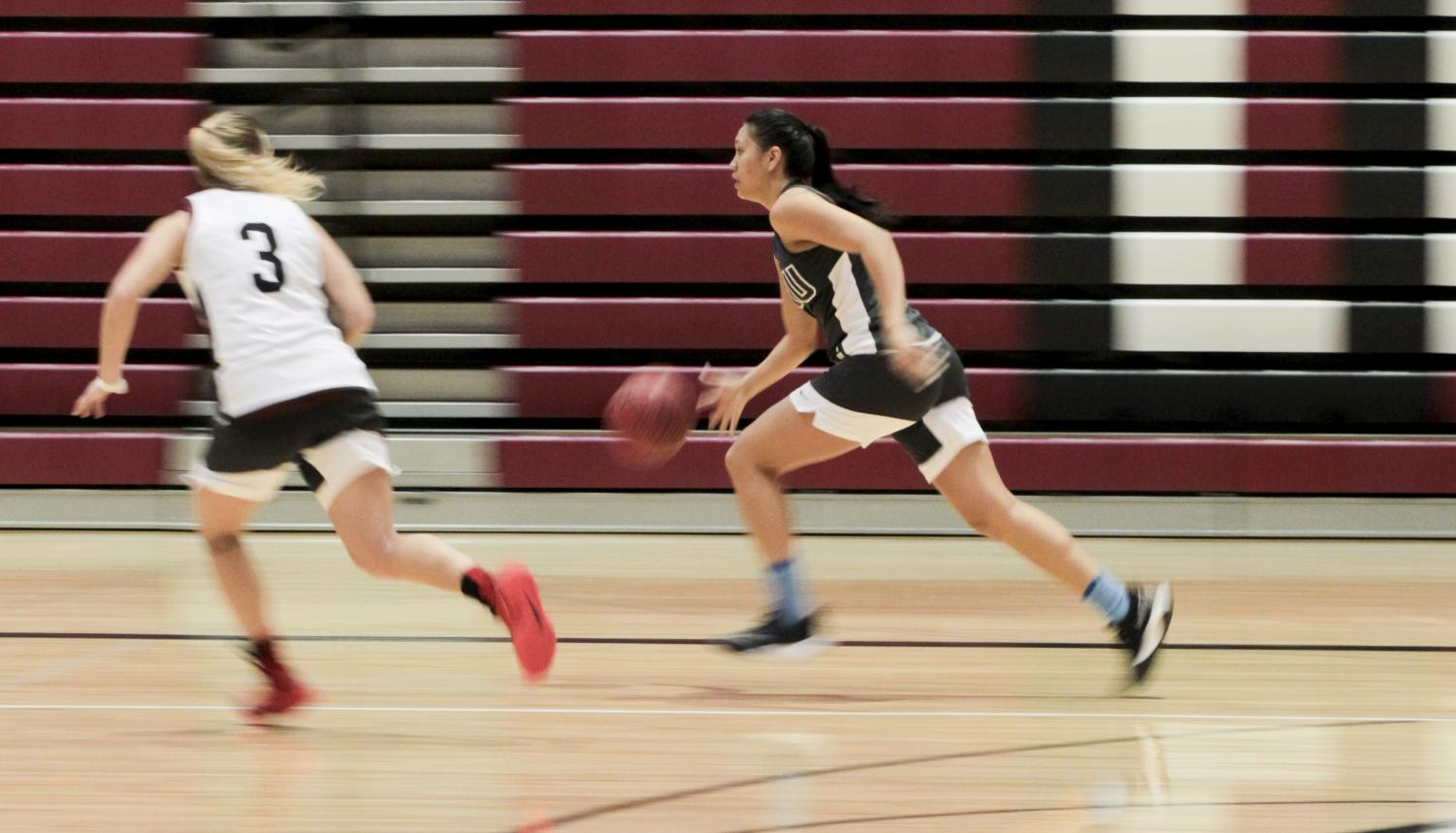 Alexis Pana shoots free throws during practice with a .700 percent over two seasons.