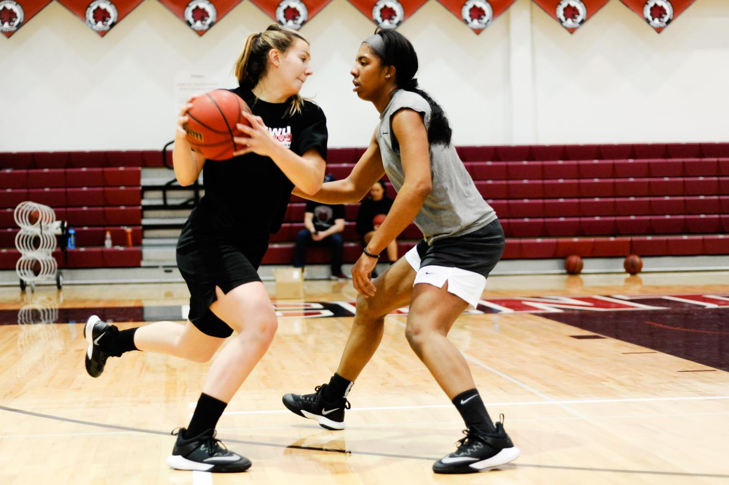 Joanna Richardson guards Sadie Mensing in a drill during practice.