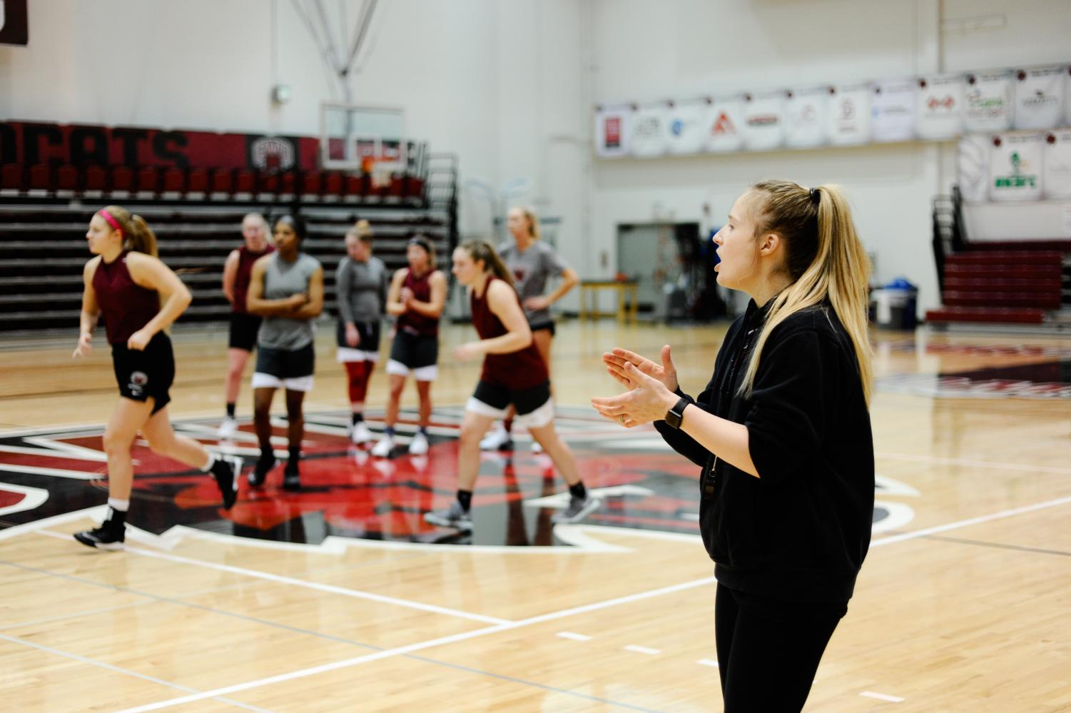 Head coach Randi Richardson-Thornley gives instruction for team drills during practice at Nicholson Pavilion.