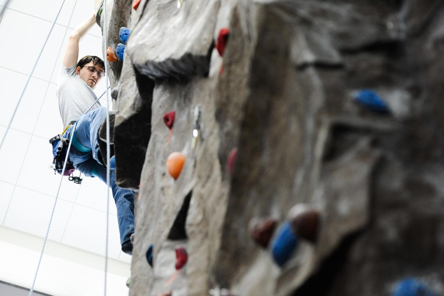 Martin Mattes scales the rock wall in the SURC Recreation Center for the Vertical Challenge.