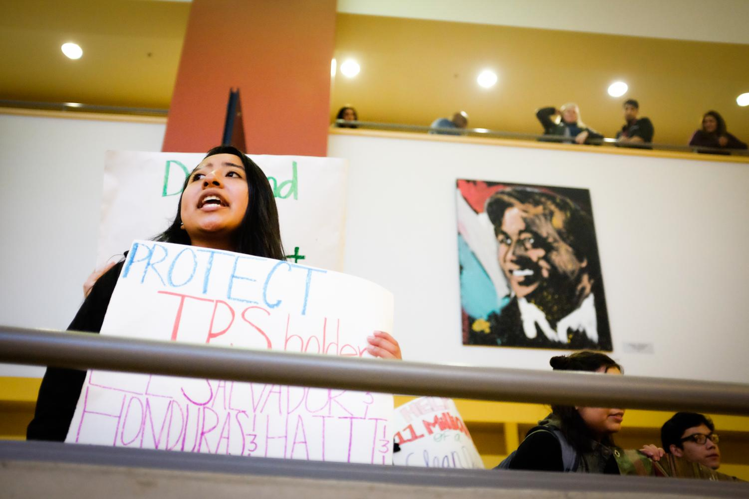 Liliana Fausto and other demonstrators perform chants in the SURC.