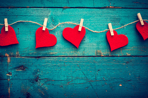 Valentines+day+hearts+on+wooden+background