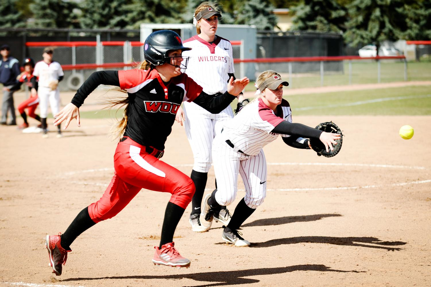 Taelor Griffin passes the ball to first base in an attempt to out a Western Oregon University in the top of the fourth inning
