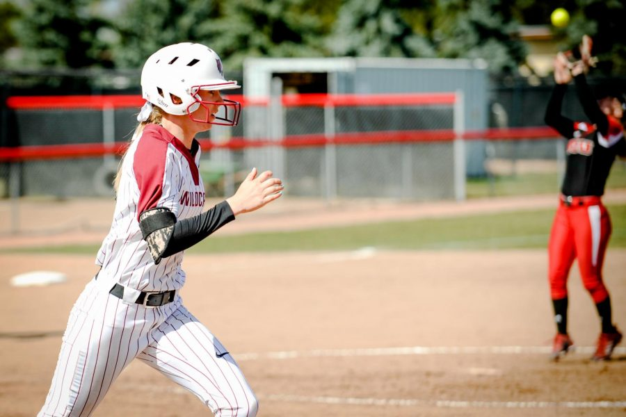 Theresa+Moyle%2C+after+hittin+the+ball%2C+runs+to+first+base+in+a+game+against+Western+Oregon+University.