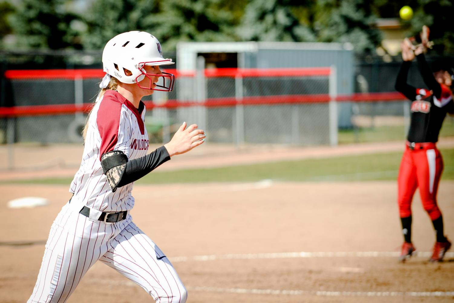 Theresa Moyle, after hittin the ball, runs to first base in a game against Western Oregon University.