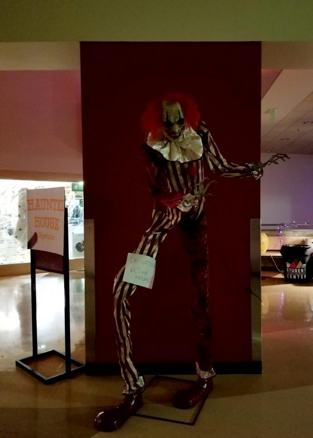 Scary Halloween decorations are posed around the SURC.