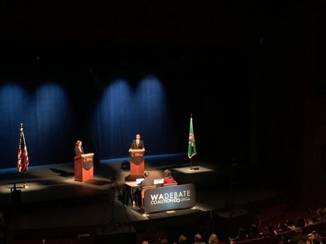 Schrier and Rossi debate in McConnell Hall
