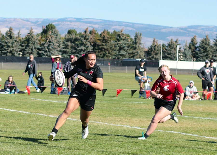 Suiluana Sooialo A'au running into the try zone to score five points for CWU's women's rugby team.