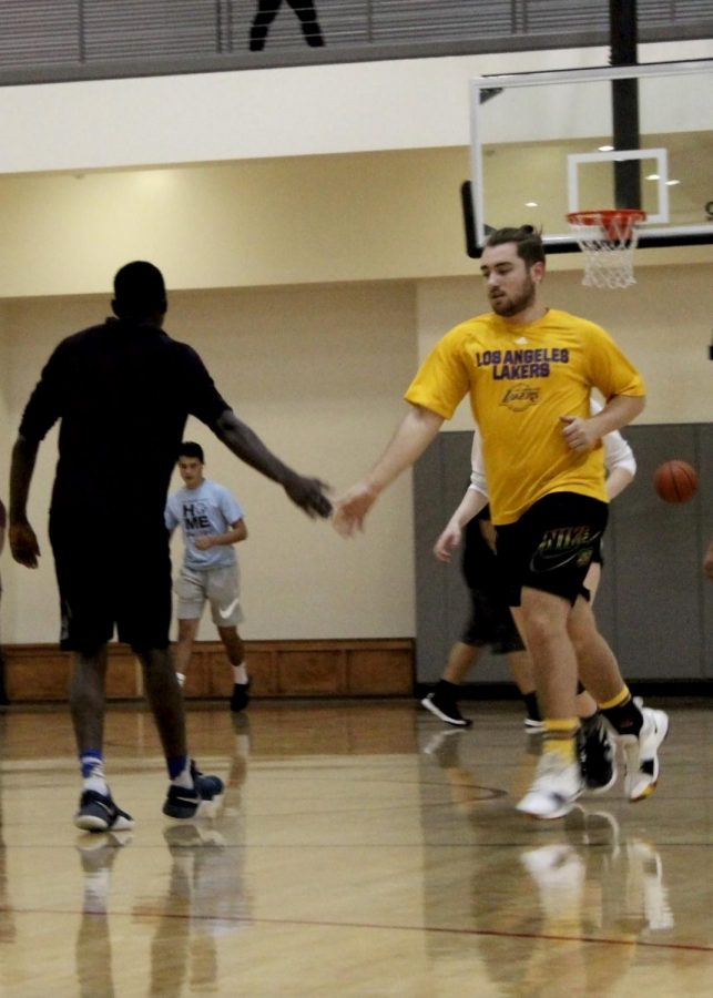 Mario (left) and Alec (right) celebrate scoring during a fun game of basketball.